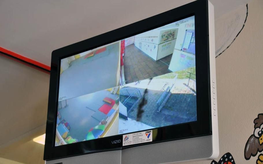 A video screen monitor is on display inside the entrance to the Child Development Center on Askern Manor in Schweinfurt, Germany.