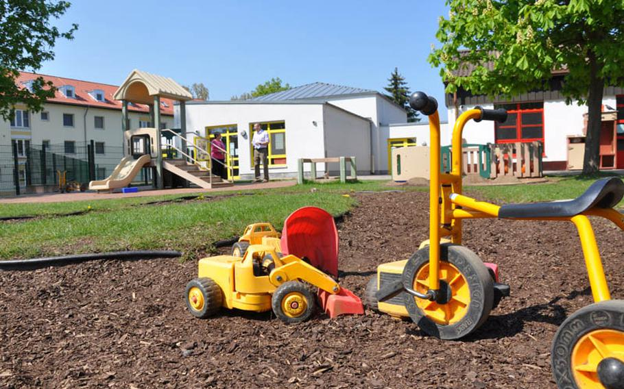 A tricycle and a toy truck sit outside the Schweinfurt (Germany) Child Development Center on Tuesday. U.S. Army Garrison Schweinfurt is investigating an allegation of inappropriate behavior at the center, according to an Army official.