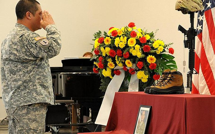A soldier gives a final salute Wednesday to Staff Sgt. Jose M. Caraballo Pietri at a memorial ceremony for the 1st Battalion, 84th Field Artillery soldier in Baumholder, Germany.