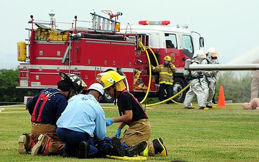 Japanese emergency responders tend to a simulated casualty during an annual bilateral training exercise between the U.S. military and Japanese Emergency Response Teams. The exercise involved approximately 120 Japanese and 60 U.S. service members.