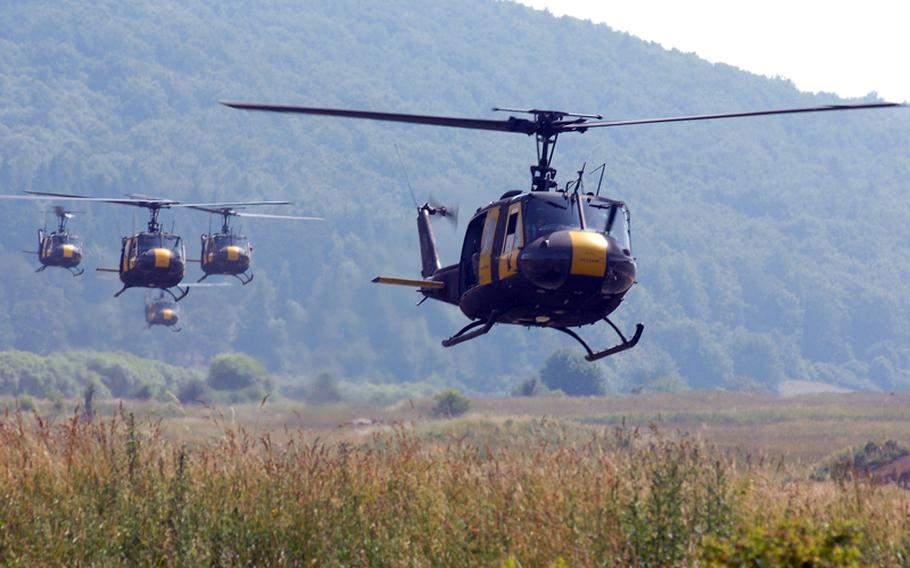 """U.S. UH-1 helicopters prepare to drop German troops during air assault training at Hohenfels, Germany, in 2008. The """"Huey"""" was retired from U.S. Army Europe service in a Wednesday ceremony at Hohenfels."""