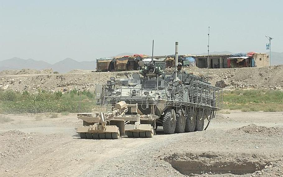 A 2nd Stryker Cavlary Regiment Stryker armored personnel carrier on the road in Kanadahar Province, Afghanistan last summer.