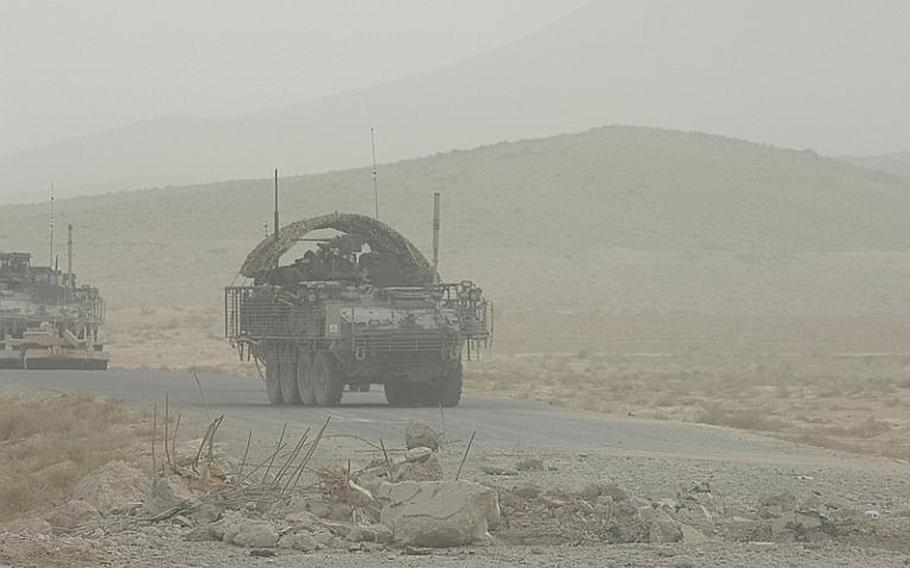 2nd Stryker Cavlary Regiment Stryker armored personnel carriers approach the site of a large IED (improvised explosive device) blast in Kanadahar Province, Afghanistan last summer.