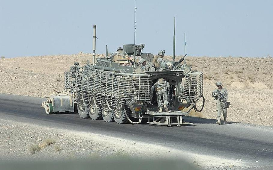 2nd Stryker Cavalry Regiment soldiers mount Stryker armored personnel carrier during a patrol in Kandahar province, Afghanistan last summer.