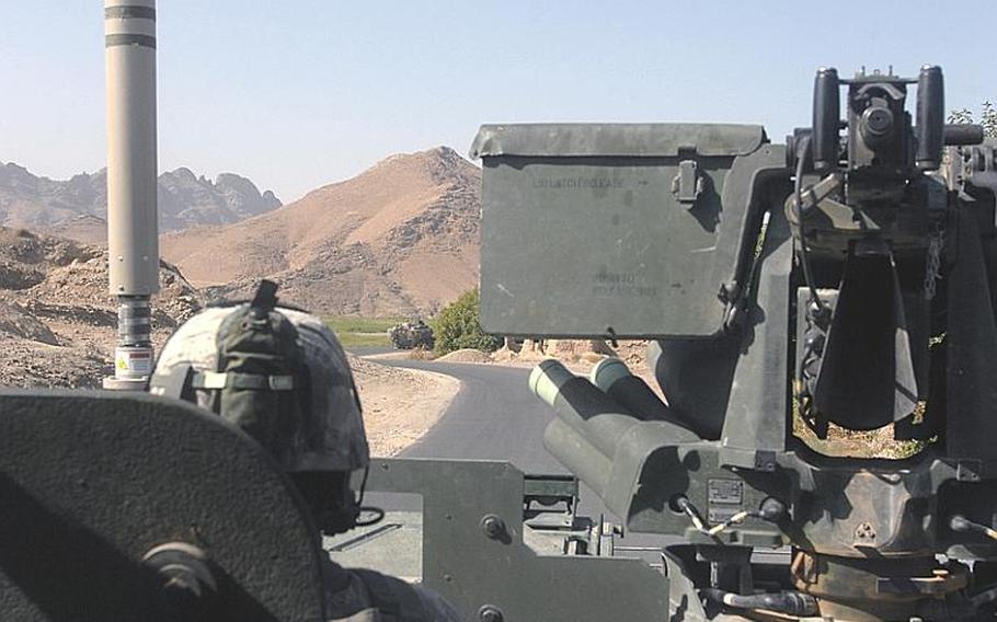 A 2nd Stryker Cavalry Regiment Stryker rolls along Route Bear, Afghanistan