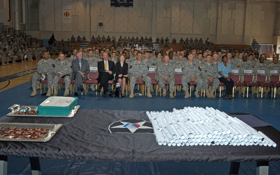 Diplomas and certificates sit on a table prior to being distributed at a Warrior University Recognition Event Thursday at Camp Casey in South Korea. More than 200 members of the 2nd Infantry Division were honored for taking at least five college classes -- and maintaining at least a 3.0 average -- since the Warrior University program was started 18 months ago. The program allows soldiers off work two hours early two days a week if they  attend college classes.