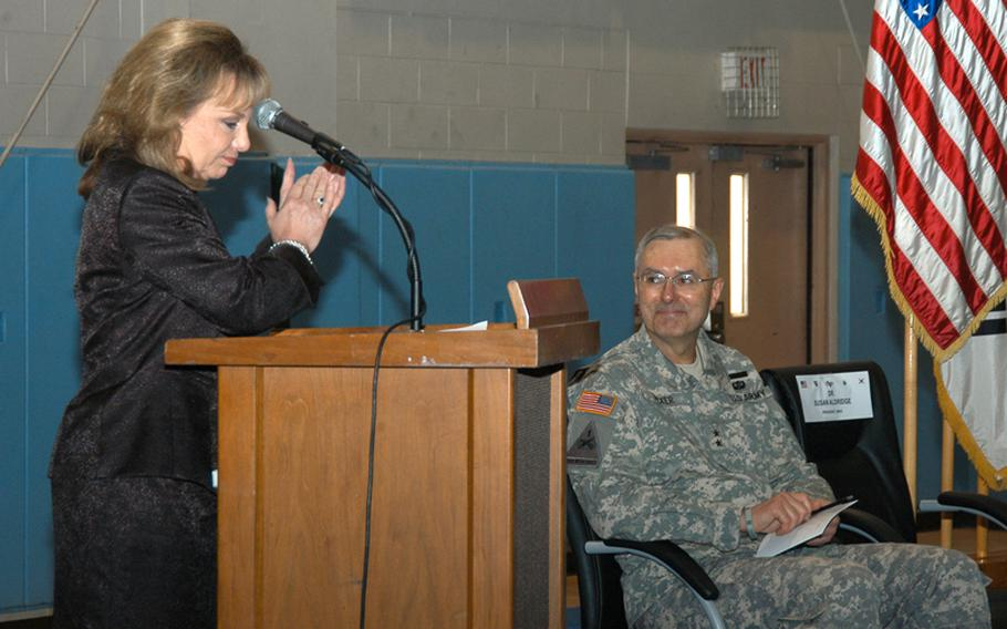University of Maryland University College President Susan Aldridge leads the audience in applause for Maj. Gen. Michael Tucker, the commander of the 2nd Infantry Division, for his Warrior University program Thursday at Camp Casey in South Korea. Tucker says a significant drop in crime among his division can be attributed to the program, through which soldiers are encouraged to take college classes.