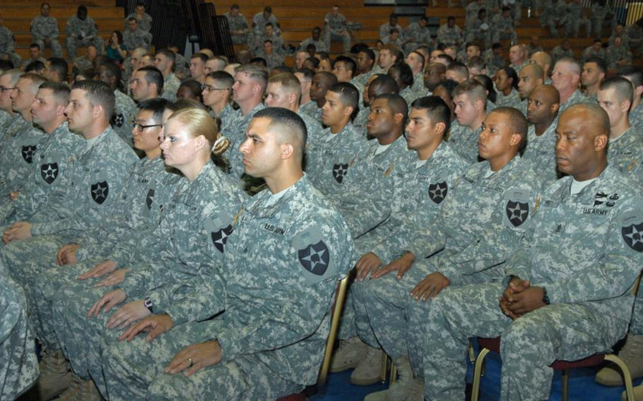 Second Infantry Division soldiers look on during a Warrior University Recognition Event Thursday at Camp Casey in South Korea. More than 200 soldiers were honored for completing at least five college classes and maintaining at least a 3.0 average through Warrior University. The program encourages soldiers to take college classes and is being credited by 2ID officials with a significant drop in crime among soldiers in the ranks.