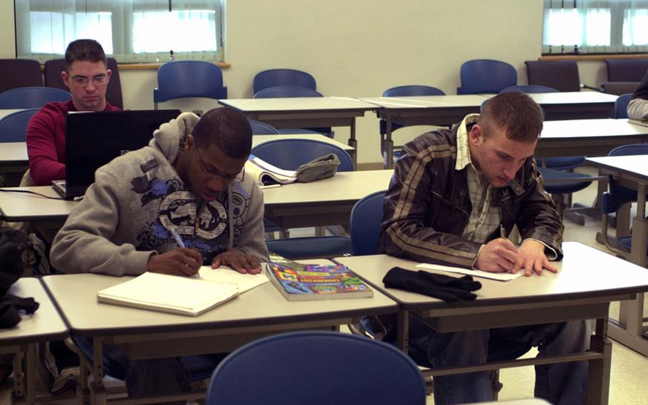 Second Infantry soldiers take notes during a 2010 Warrior University class at Camp Red Cloud in South Korea.