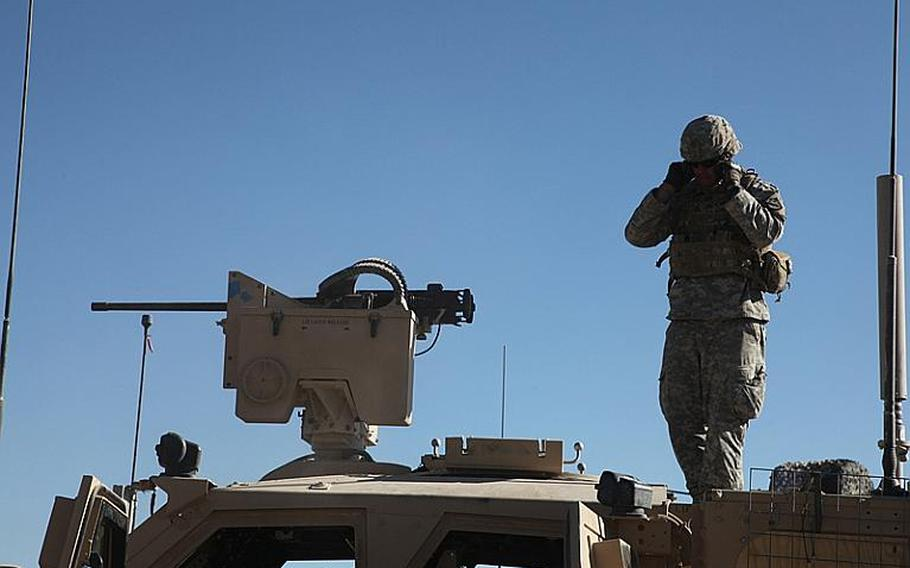 U.S. Army Sgt. Jacob McHenry, with Security Forces Advisory Team (SFAT), 3rd Zone, Afghan Border Police (ABP), plugs his ears during the firing test of an M2 HB heavy machine gun in Kalah Rashid Checkpoint, Kandahar province, Afghanistan, Nov. 12, 2010. The Service members with SFAT 3 performed logistical assessments of ABP checkpoints along the southern borders of the Kandahar and Zabul provinces in support of the International Security Assistance Force.