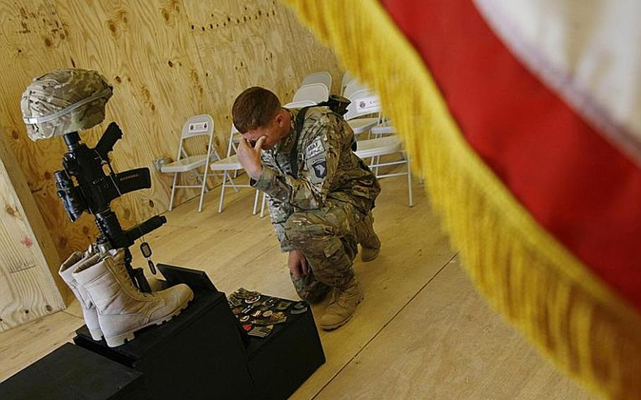 Spc. Matthew Woodall of Company E, 2nd Battalion, 506th Infantry Regiment, 4th Brigade Combat Team, 101st Airborne Division, pauses after a memorial service for Pfc. Anthony Nunn, 19, at Forward Operating Base Zerok in Paktika province, Afghanistan, on June 2, 2011.
