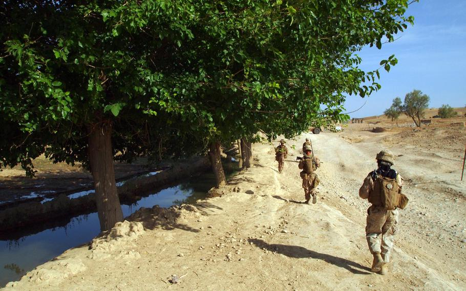 Marines of Company I, 3rd Battalion 2nd Marines return to base after an early morning patrol May 27 to engage with locals.