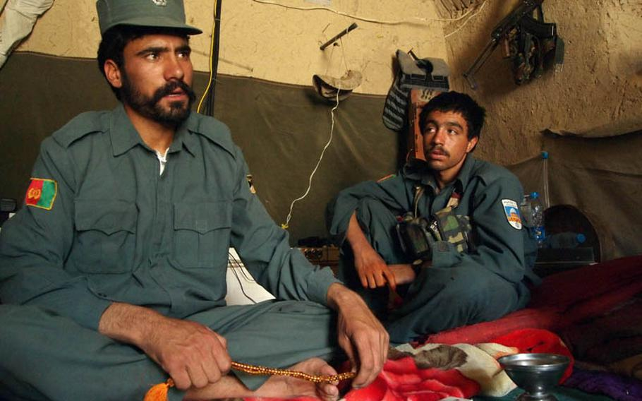 Nooroz Waly, left, who commands 30 police in northern Musa Qala district in Helmand province, has taken the initiative in trying to round up Taliban threatening his village.