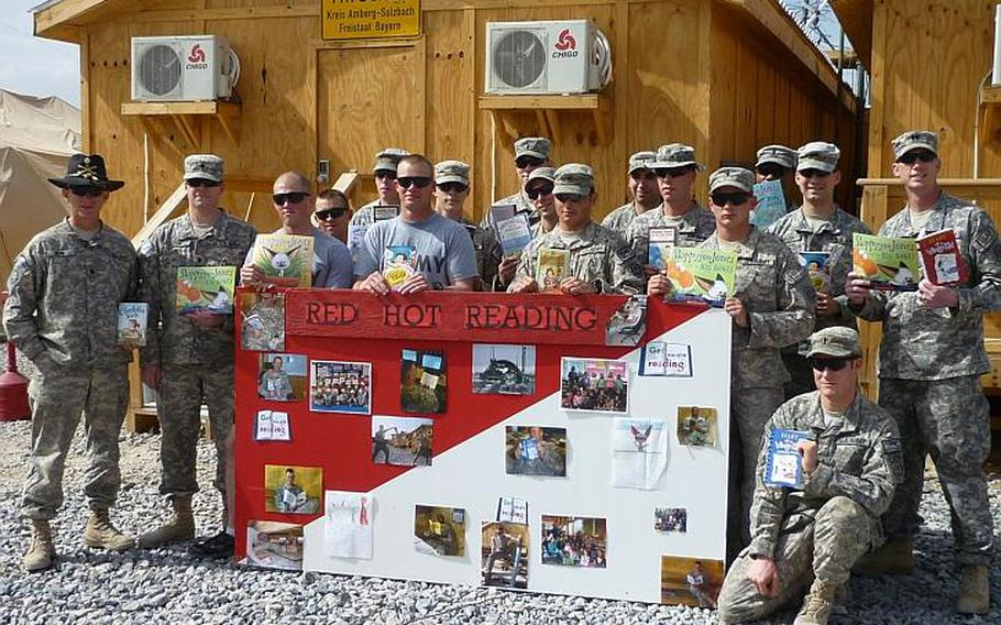 Soldiers of the Vilseck-based 2nd Stryker Cavalry Regiment pose with some of the books they read while in Afghanistan in partnership with students at the Vilseck Elementary School during Red Hot Reader Month in March. Courtesy of Vilseck Elementary School