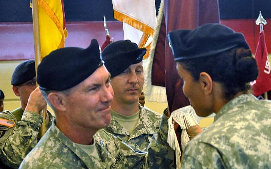 Army Col. Jeff B. Clark receives the Landstuhl Regional Medical Center colors from Army Brig. Gen. Nadja Y. West, signifying Clark as the new commander of Landstuhl. West is the commanding general for Europe Regional Medical Command.   Seth Robbins/Stars and Stripes