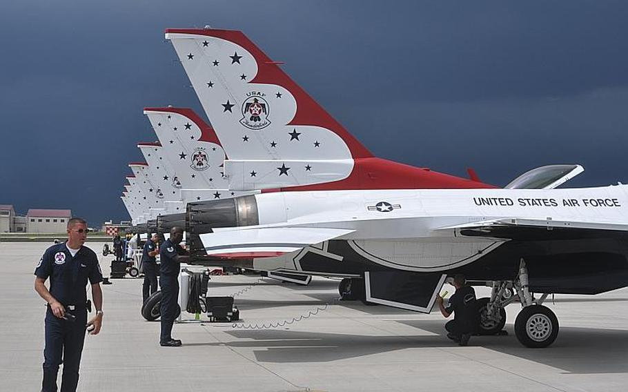Crewmembers work on the nine F-16s  of the U.S. Air Force's Thunderbirds shortly after they landed Thursday at Aviano Air Base, Italy. The jets will be taking part in an Italian air show Saturday and Sunday in nearby Jesolo and will be using Aviano as their home base until they depart Tuesday for Denmark.