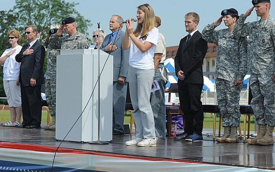 """Mannheim High School student Kaitlin Laws sings the national anthem at the """"Moving On"""" celebration Thursday marking the closing of the high school and middle school."""
