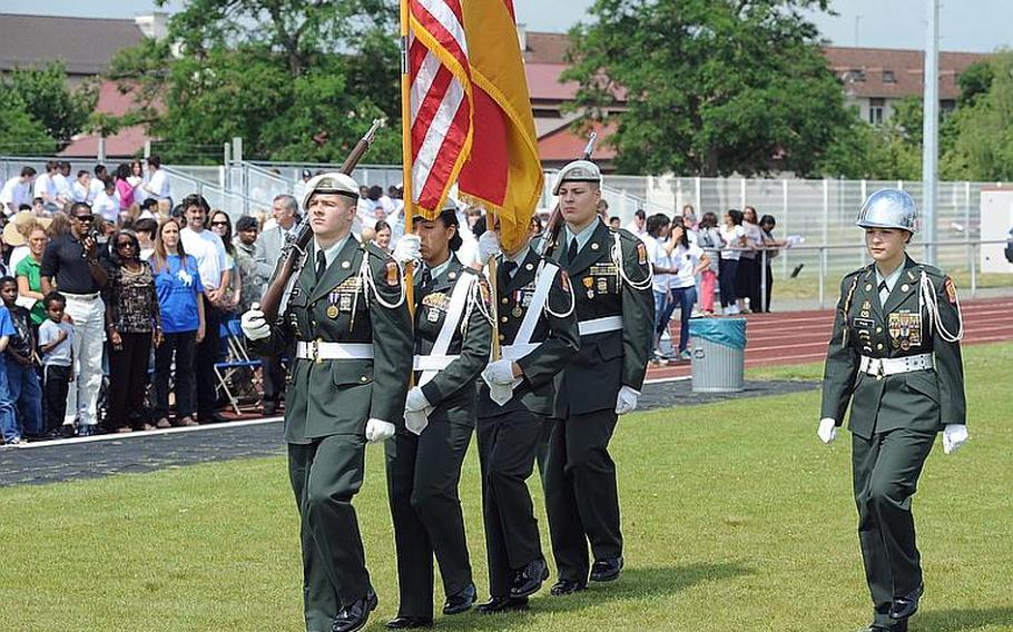 The Mannheim High School Junior ROTC color guard marches off Woods Memorial Field for the last time at a closing ceremony for the school and the middle school on Thursday.