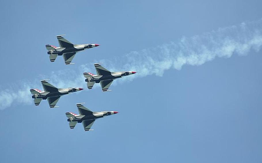 Four of the six Air Force Thunderbirds participating in an the Jesolo Air Extreme air show east of Venice on Saturday fly in a diamond formation past the smoke left by a fellow F-16 that had just passed. The U.S. jets  performed for about half an hour in the three-hour show.