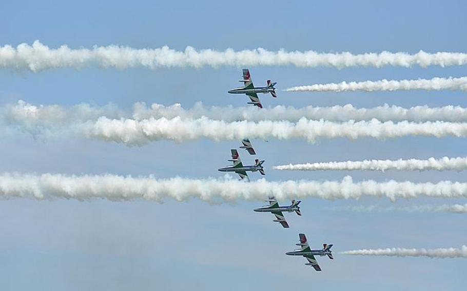 Five members of Italy's Frecce Tricolori team almost got lost in the smoke put forth by their fellow team members after the jets had made a series of passes