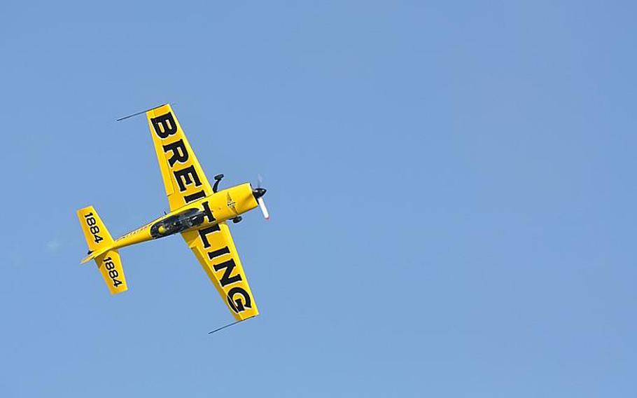 Military jets were joined by civilian aircraft at Jesolo Air Extreme, including this bright yellow one whose pilot repeatedly climbed high into the sky and appeared to cut off its engines, drifting down towards the Adriatic Ocean before re-engaging and zooming into another maneuver.