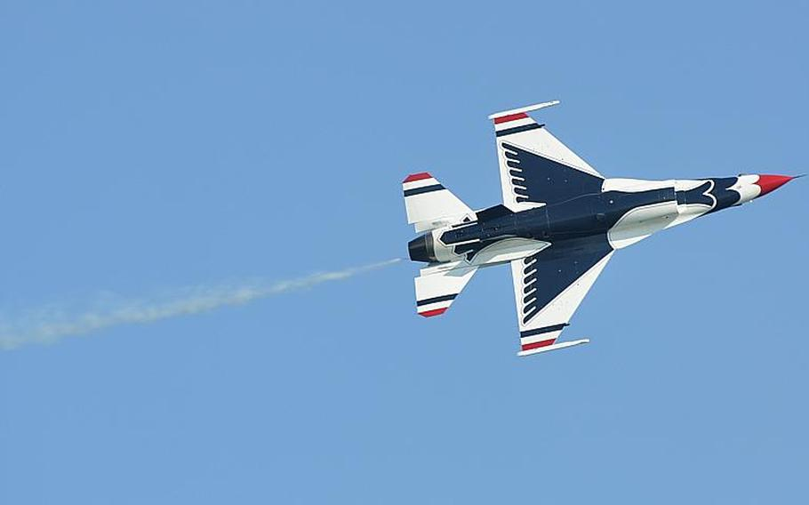 A lone member of the U.S. Air Force's Thunderbirds flies over the Adriatic Sea on Saturday during the Jesolo Air Extreme air show east of Venice. Thousands of spectators lined the beaches near Jesolo or leaned out windows facing the ocean to watch the three-hour show, which was set to be duplicated on Sunday.