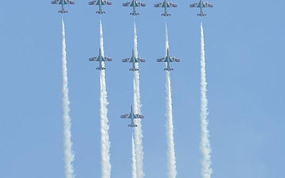 Nine members of the Frecce Tricolori aerial acrobatic team - Italy's equivalent of the U.S. Air Force Thunderbirds - leave trails of smoke while soaring straight up into the sky during the Jesolo Air Extreme air show Saturday east of Venice. Thousands of spectators watched the three-hour show over the Adriatic Sea from beaches filled with sun-seeking tourists.