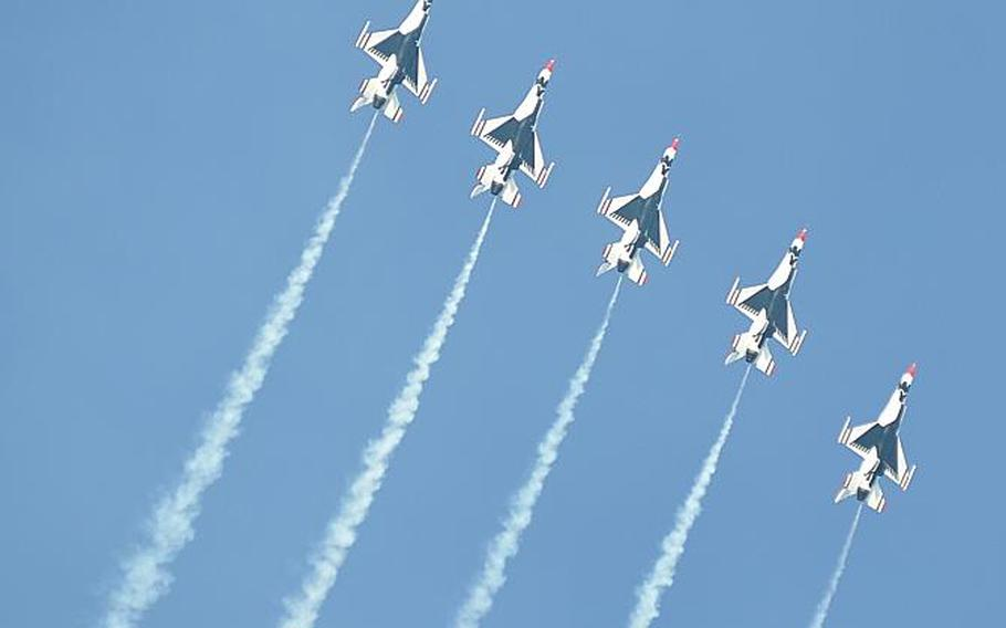 Five of the six participating U.S. Air Force Thunderbirds soar upward in formation during the Jesolo Air Extreme show Saturday over the Adriatic Sea near the beaches of Jesolo, Italy.