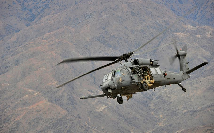 Pilots fly an HH-60G Pave Hawk Staff assigned to the 83rd Expeditionary Rescue Squadron during a recent mission over Afghanistan. Squadron crews helped rescue downed Army helicopter pilots during a five-hour mission on April 23.