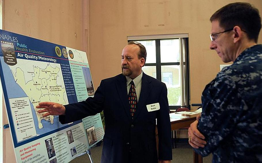 Matthew Soltis, vice president of the environmental company Tetra Tech and a project manager for the Naples Public Health Evaluation, explains results of a year-long air monitoring study his company performed to determine if Naples' air quality posed a health risk to Naples families to Lt. Cmdr. Rick Larson, a base official attending an open house on the review.