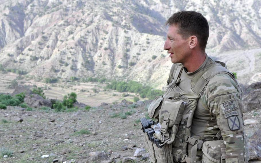 Sgt. Frank Cuchina is shown during a mid-June mission in the Azra district of Logar province, far from the Hooters restaurant he used to manage in Melbourne, Fla.