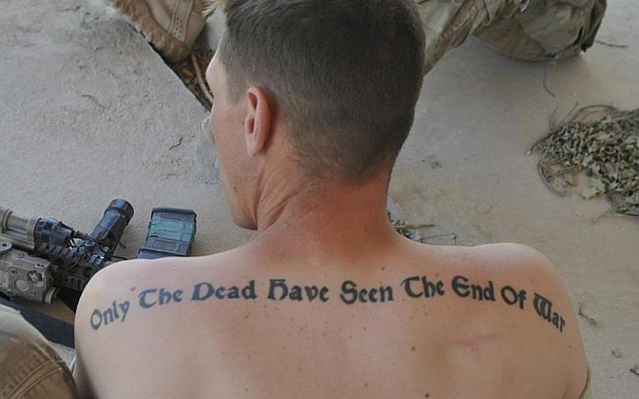 During down time on a mid-June mission in the Azra district of Logar province, Sgt. Frank Cuchina showed off the quote he has tattooed across his shoulders.