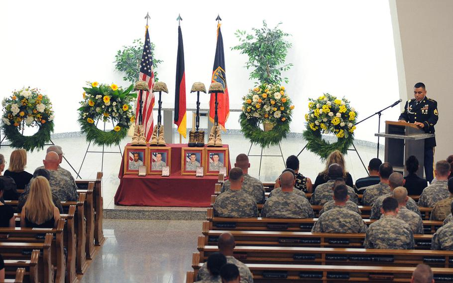 Staff Sgt. Limber Pinedo reads remarks from the memorial ceremony in Afghanistan for Sgt. 1st Class Alvin Boatwright, Staff Sgt. Edward Dixon, Staff Sgt. Alan Snyder and Spc. Tyler Kreinz, during a memorial ceremony Wednesday in Baumholder, Germany.