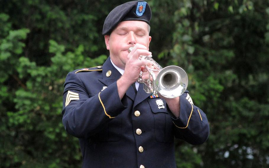 Sgt. Jonathan Johnson of the U.S. Army Europe band plays taps at the memorial ceremony for Sgt. 1st Class Alvin Boatwright, Staff Sgt. Edward Dixon, Staff Sgt. Alan Snyder and Spc. Tyler Kreinz, in Baumholder, Germany, on Wednesday. The four 170th Brigade Combat Team soldiers were killed in Afghanistan when their vehicle overturned on June 18.