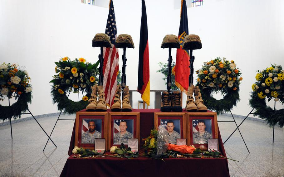 The display at the memorial ceremony for Sgt. 1st Class Alvin Boatwright, Staff Sgt. Edward Dixon, Staff Sgt. Alan Snyder and Spc. Tyler Kreinz in Baumholder, Germany, on Wednesday. The four 170th Brigade Combat Team soldiers were killed in Afghanistan when their vehicle overturned on June 18.