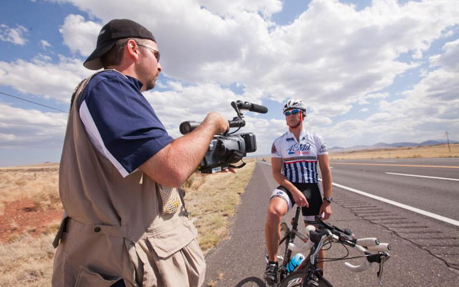 Ernie Holly, a filmmaker working on a documentary about the 30th anniversary of RAAM, interviews Justin Martin along the route in Arizona.