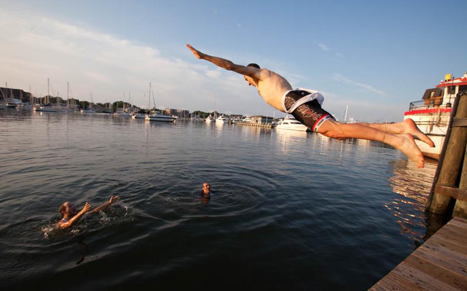 After the finish, racers celebrated by jumping into the Chesapeake Bay. Pictured in air is Joe Arnone.