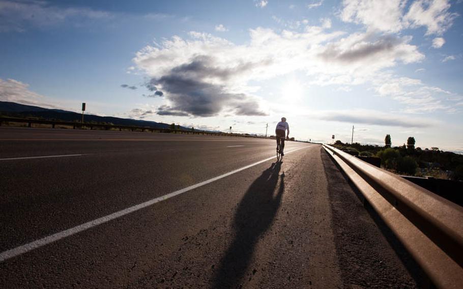 Jim Weinstein rides into a Colorado sunrise.