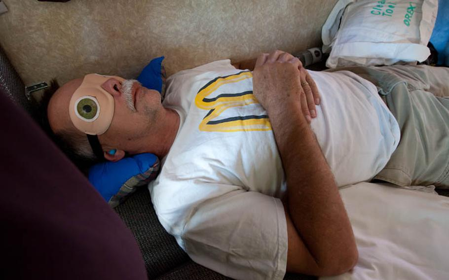 Phil Houck grabs a quick nap with a blindfold on. Most crew members were lucky to get more than four hours of sleep per day.