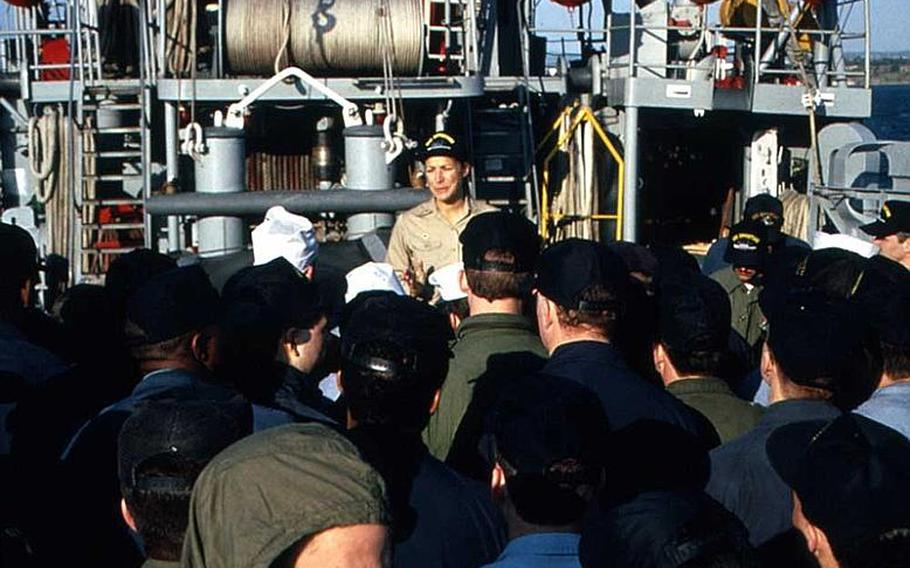 Retired Navy Cmdr. Darlene Iskra, shown addressing her crew aboard the USS Opportune days after becoming the first woman to command a commissioned vessel, said that many hurdles still exist when it comes to gender equality in the military.