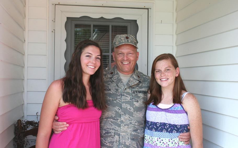 Maj. Mark Noon, with daughters Hannah and Bailey, spend a few moments together at their Niceville, Fla., home, prior to Noon's Qatar deployment last year. Noon is among thousands of servicemembers who were not included in a $855 million government program designed to save military families from hardship related to the housing market crash.