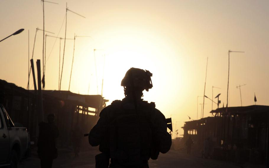 Marine Lance Cpl. Daniel Triebell, a 21-year-old squad leader from Melbourne, Fla., patrols through Lakari Bazaar on July 22. Triebell is a member of Company A, 1st Battalion, 3rd Marine Regiment.