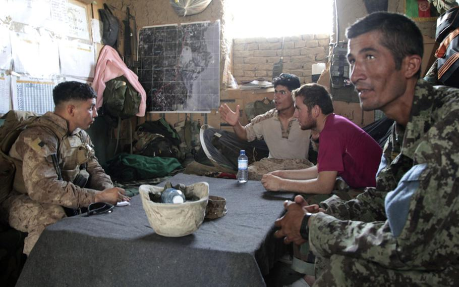 Marine 1st Lt. Mike Cubillos meets with Afghan soldiers at their base, about an hour and a half walk from the headquarters of Company B, 1st Battalion, 3rd Marine Regiment. There are nine Afghan soldiers at the base - not enough, according to their lead sergeant, Amrullah, to conduct patrols. Cubillos disagreed with Amrullah, and explained how he could man the post and patrol with that many men.