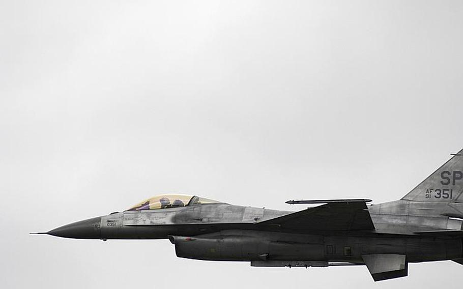 An F-16 Fighting Falcon performs flybys during the Spangdahlem Air Base open house and aerial demonstration on Saturday, July 30, 2011, in Germany.