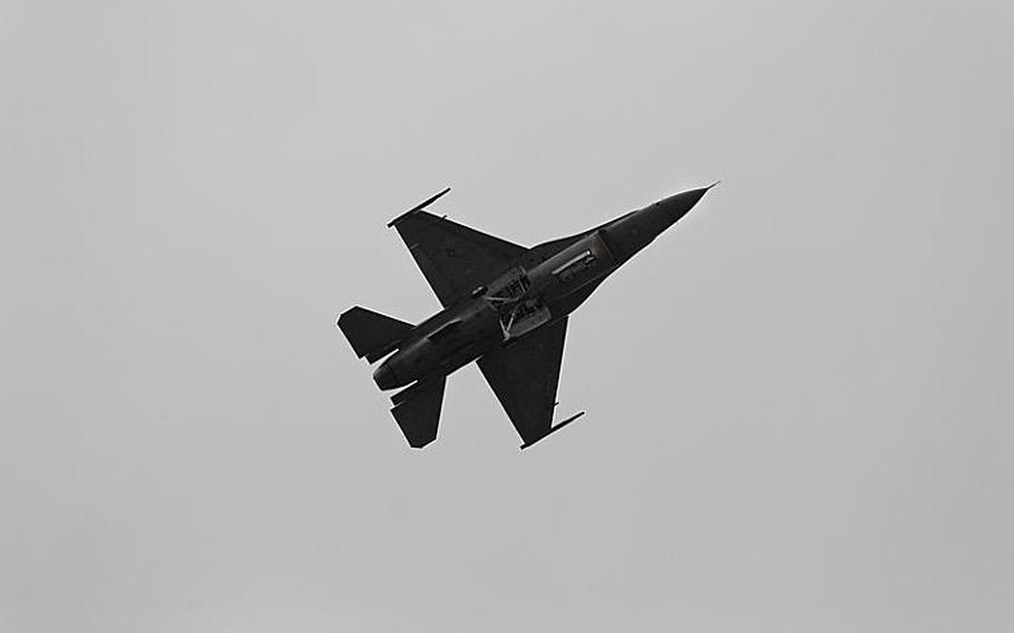 An F-16 Fighting Falcon performs Saturday, July 30, 2011, during the open house and aerial demonstration at Spangdahlem Air Base, Germany.