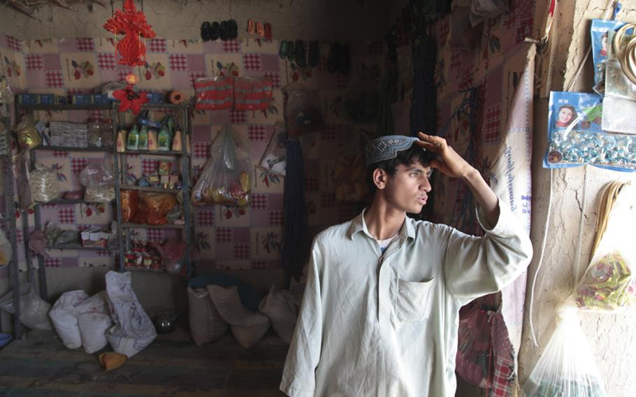 Yar Mohammed looks out his shop July 31. His store was ransacked by Afghan troops after two of their men were shot nearby.