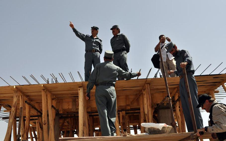 Gen. Amir Jamshid (pointing) inspects the construction site of a new prison in Maidan Shar, capital of Wardak province. Jamshid is head of Afghanistan's Central Prison Directorate.