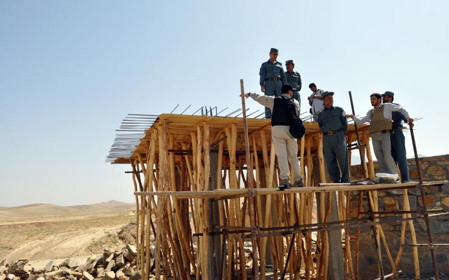 Gen. Amir Jamshid (left, on top platform) inspects the construction site of a new prison in Maidan Shar, capital of Wardak province. Jamshid is head of Afghanistan's Central Prison Directorate.