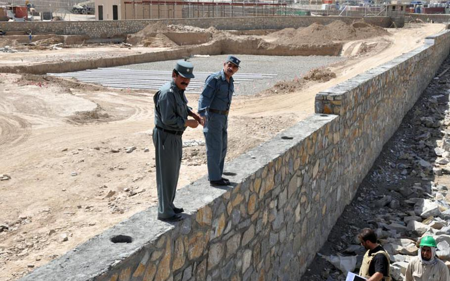 Gen. Amir Jamshid (right) inspects a wall at the construction site of a new prison in Maidan Shar, capital of Wardak province. Jamshid is head of Afghanistan's Central Prison Directorate.
