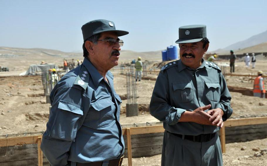 Gen. Amir Jamshid (left) talks with Col. Qayoum Jafari during an inspection at the construction site of a new prison in Maidan Shar, capital of Wardak province. Jamshid is head of Afghanistan's Central Prison Directorate; Qayoum is warden of Maidan Shar's current prison, which holds inmates in a rented residential compound.